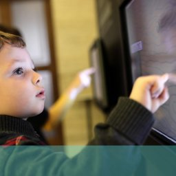 Child interacting with screen