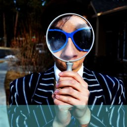 man with a magnifying glass in a loud suit