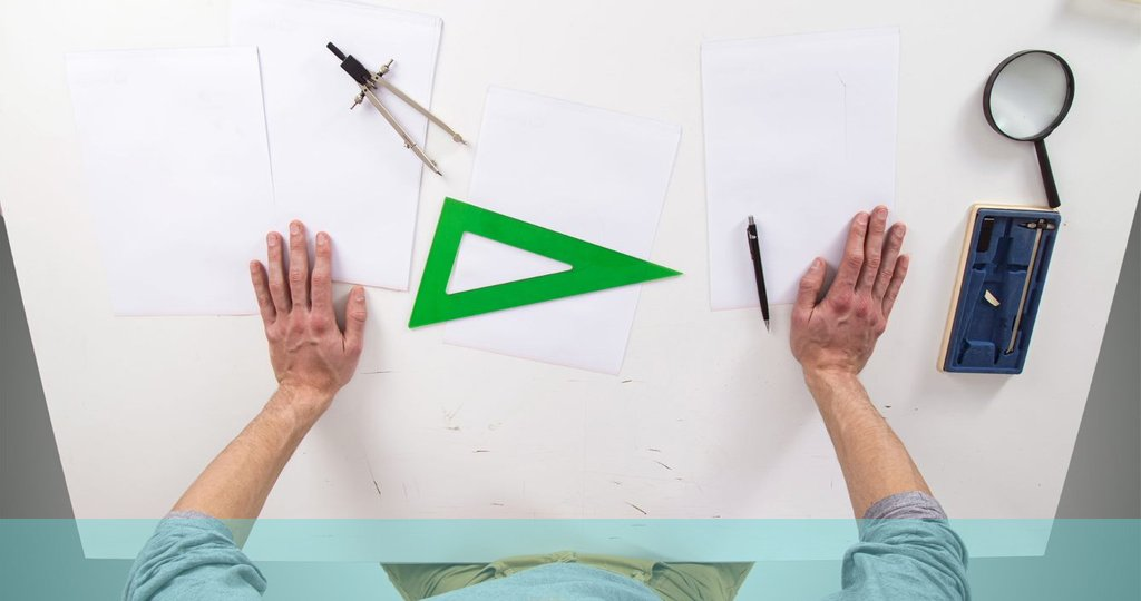 picture of hands with various design tools before starting work