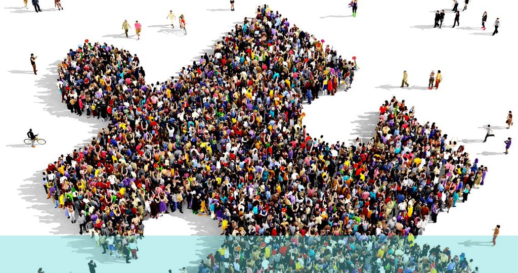 image of people in the shape of a jigsaw piece