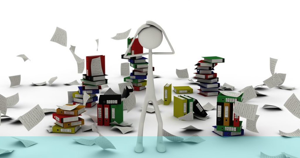 picture of a person with their hands on their head surrounded by files and documents