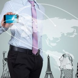 picture of person holding digital device in a connected world