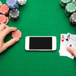 person at casino with mobile device